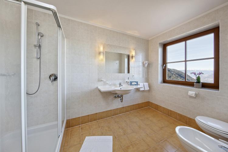 Bathroom with window and a shower